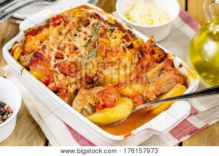 Baked potato gratin with pork meat tomatoes and cheese