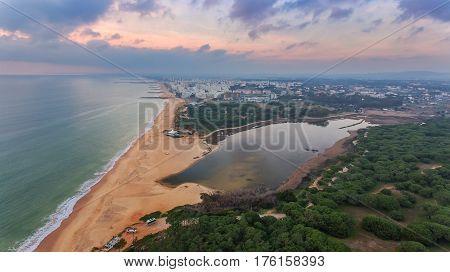 Top view Quarteira beach with tourists on the sea. Algarve region, Portugal