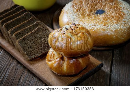 Buns With Mushrooms And Black Bread On Rustic Table