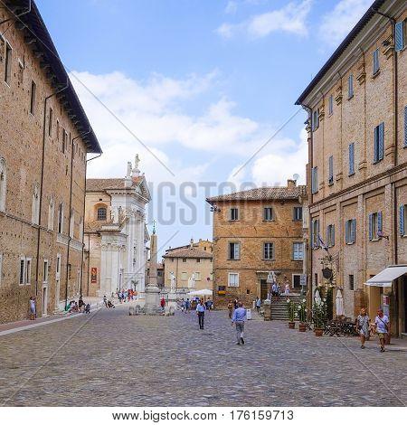 Urbino, Italy - August, 1, 2016: people on a street of Urbino, Italy