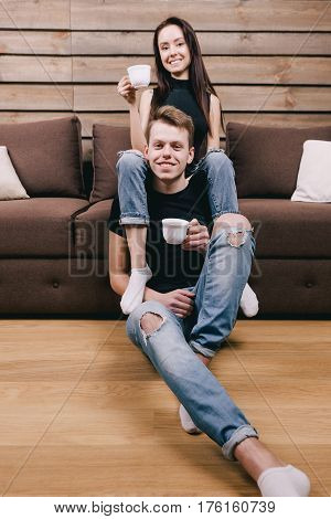 satisfied couple have fun while having lunch tea. concept of happy family life or friendly relationship between man and woman