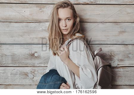 Close up fashion lifestyle portrait of young pretty woman in wooden room. Processed with VSCO f3 preset