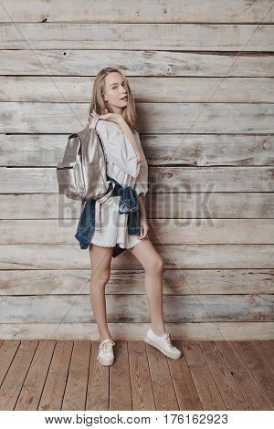 Fashion lifestyle portrait of young pretty woman in wooden room. Processed with VSCO f3 preset