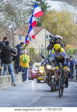 Conflans-Sainte-HonorineFrance-March 62016: The Dutch cyclist Bram Tankink of Lotto NL-Jumbo Team riding during the prologue stage of Paris-Nice 2016.