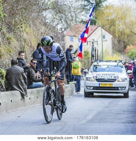 Conflans-Sainte-HonorineFrance-March 62016: The Belgian cyclist Serge Pauwels of Dimension Data Team riding during the prologue stage of Paris-Nice 2016.