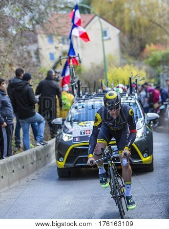 Conflans-Sainte-HonorineFrance-March 62016: The French cyclist Angelo Tulik of Direct Energie Team riding during the prologue stage of Paris-Nice 2016.