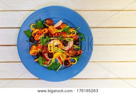 Summer Salad With Tomatoes White Plate On Wood Table