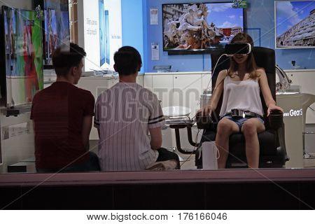 Kiev Ukraine - Girl trying on virtual reality glasses in a Samsung brand store on Khreshchatyk Street