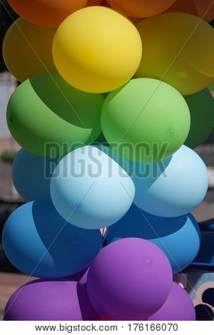 Multicolored inflatable balls on the street closeup. Celebration
