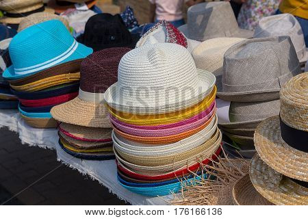 Varied fashion hats showcase on open market shop