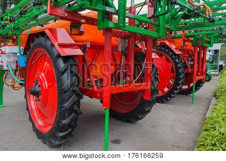 Elements of agricultural machinery at the exhibition closeup