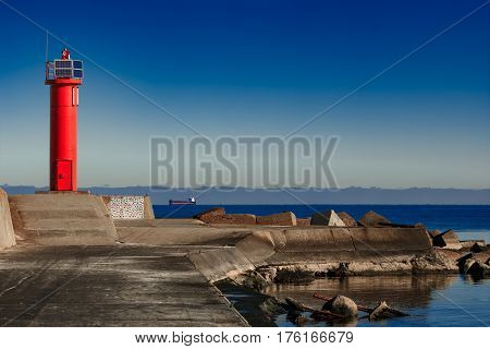 Red Lighthouse On Breakwater Dam