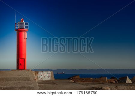 Red lighthouse on breakwater dam in Riga Europe