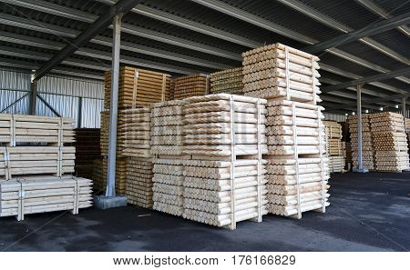 stacks of lumber for the construction of stacked in a warehouse