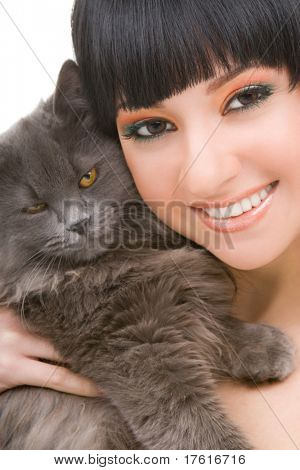 portrait of fashion woman with funny kitten poster