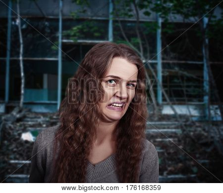 Young woman with face depicting disgust