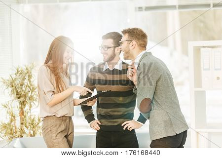 business team discussing working papers in the lobby of the modern office.the photo has a empty space for your text.