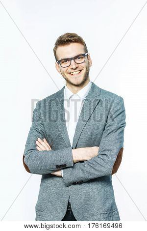 successful Manager in glasses on a light background.the photo has a empty space for your text.