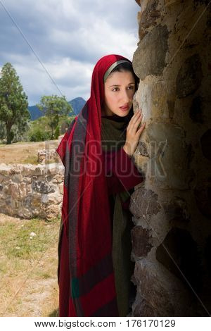 Mary Magdalene standing at the entrance of the empty tomb of Jesus on Easter morning