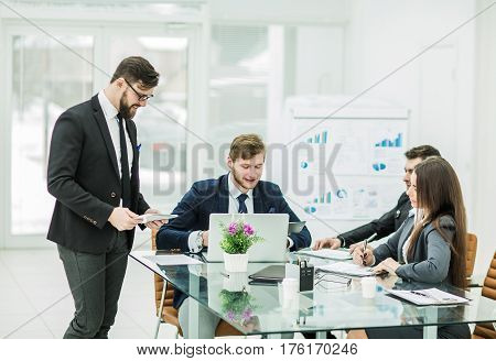business team of professionals prepares a presentation of a new financial project.the photo has a empty space for your text