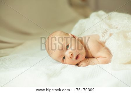 portrait of a newborn baby in the parents ' bed.the photo has a empty space for your text
