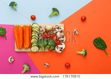 Healthy eating, vegetarian diet background. Vegetable food, copy space. Ingredients for salad or soup - mushroom, cherry tomato, broccoli, cucumber, carrot on bright background