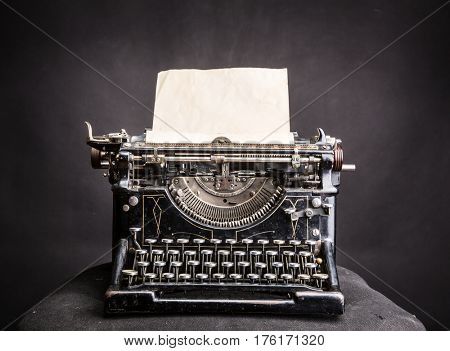 Vintage black typewrite with inserted paper sheet