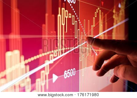 A city worker Analysing illustrated stock market financial data on a screen.