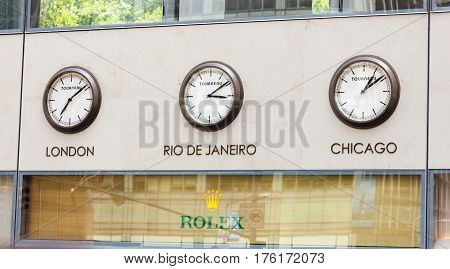 Rolex Showcase With Clocks On The Wall With Time Zones.