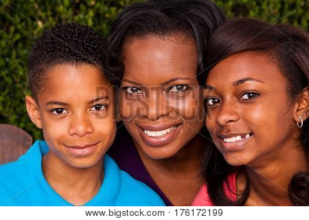 Loving African American mother and her children.