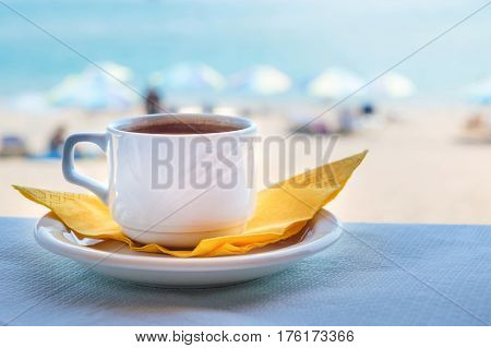 Cup Of Coffee At The Beach
