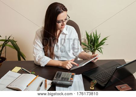 Female bookkeeper hands holding tablet pc