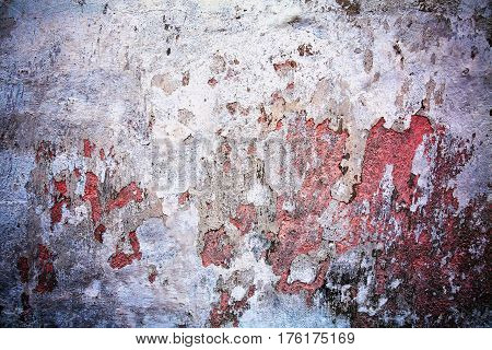 Old wall from which the paint is flaking