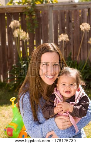 Portrait of a mother and her biracial daughter.