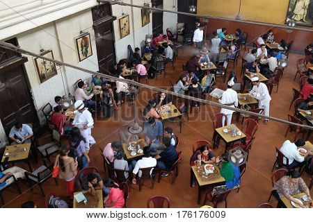 KOLKATA, INDIA - FEBRUARY 11, 2016: Visitors of popular Indian Coffee House have lunch in Kolkata. The India Coffee House chain was started by the Coffee Cess Committee in 1936 in Bombay