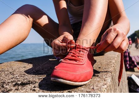 Young Girl Tying Shoelace.