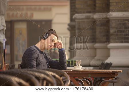 Bored Young Man Sitting Caffee Table