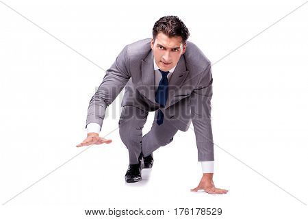 Businessman on start ready for running isolated on white