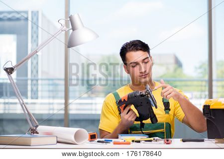 Construction worker sitting at the desk