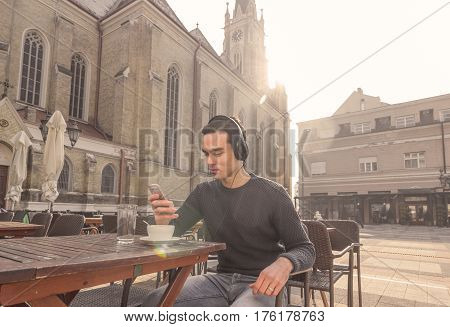 One Young Man Smartphone Headphones Outdoors Cathedral