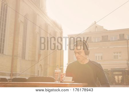 Strong Bright Sunlight Man Sitting Cafe Table Outdoors