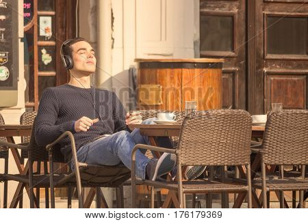 Young Man Headphones Relaxing Enjoying Music Listening