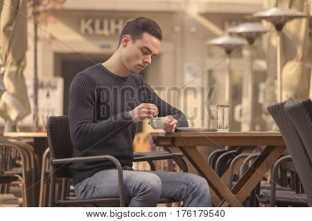 Young Man Stirring, Coffee Cup, Outdoors Day
