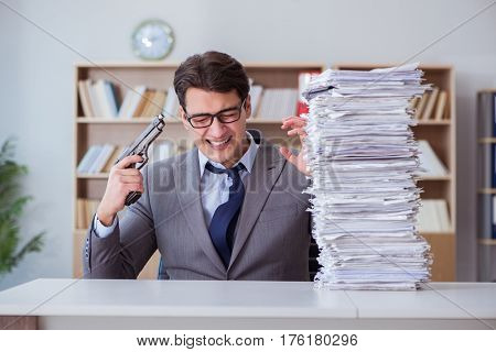 Businessman busy with paperwork in office