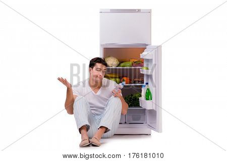 Man next to fridge full of food