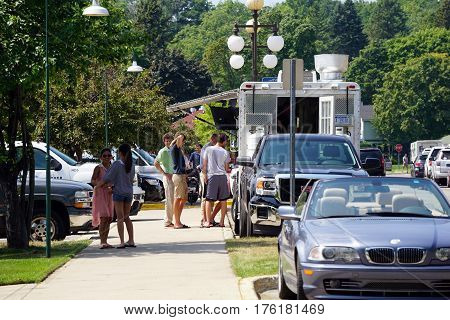 HARBOR SPRINGS, MICHIGAN / UNITED STATES - AUGUST 4, 2016: People purchase food from an Etta's