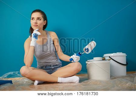 bright picture of lovely housewife painting at home