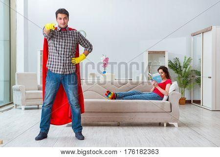 Superhero husband helping his wife at home