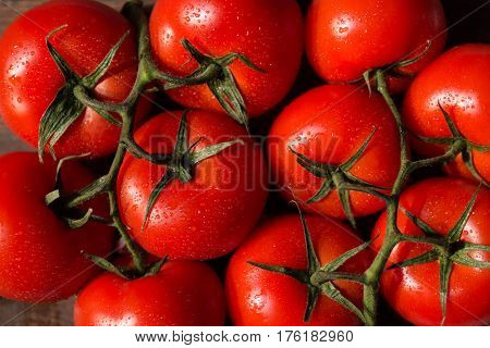 Top View Of Hydroponic Cherry Tomatoes On Vine. Healthy Organic Food Background.