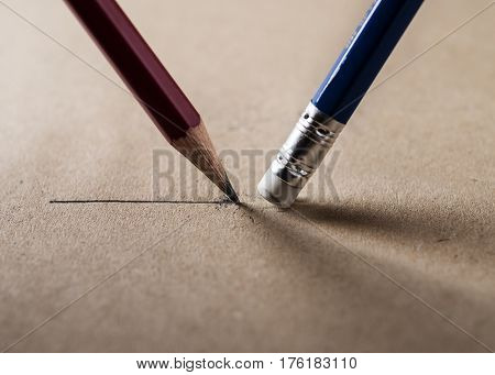 Write and erase concept Close up of a sharpened pencil writing a straight line and eraser pencil